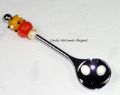 Condiment Spoon with Handmade Lampwork Glass Bead of Orange and Black