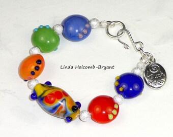 Bracelet of Red, Blue, Green Lampwork Beads