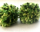 2 green pom pom hair ties/ponytail holder