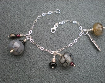 I'll Fly Away charm bracelet, one of a kind, sterling silver, black fire agate, garnet, feather charm