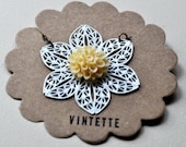 Necklace. Carmella. Cream cabochon on white filigree flower. On short delicate brass chain. By Vintette on Etsy.