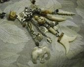 Treasured Trinkets sterling silver carved bone ivory elephant bat