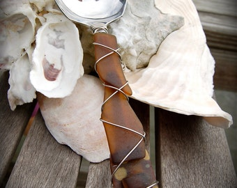 """Sea Glass Slotted Serving Spoon made with Recycled Bottle """"Tumbled Island Glass""""  in Tortoise Shell Amber. Dishwasher Safe Stainless steel"""
