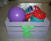 Child's toy box with letter
