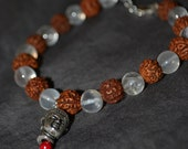 Rudrashka & clear crystal beaded bracelet with Buddha head bead.
