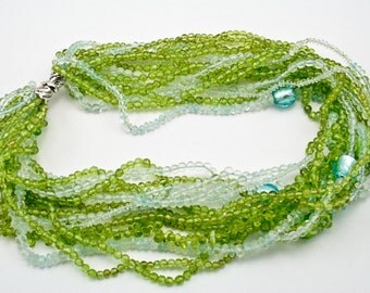 Multistrand  (15)  peridot and aquamarine  necklace, sterling silver clasp