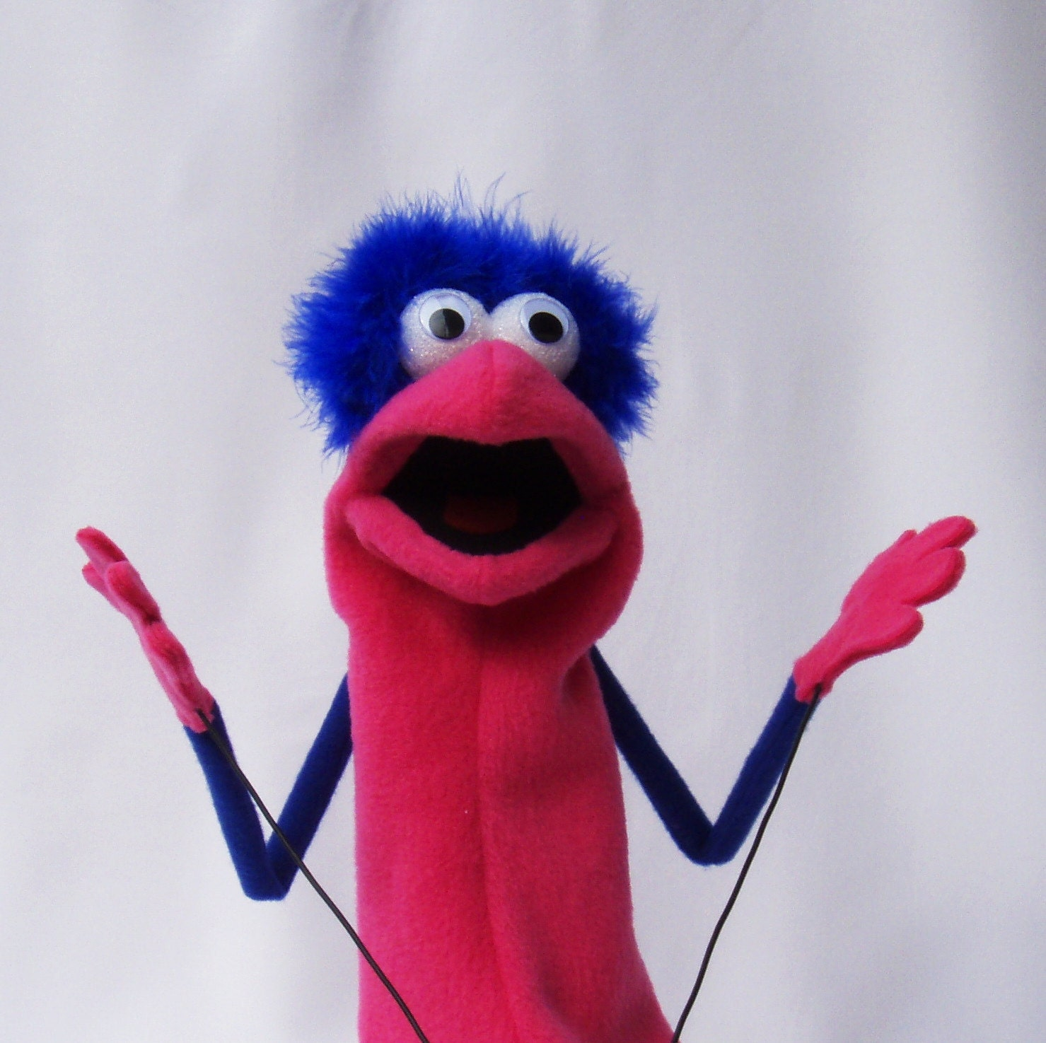 Hand puppet with rod arms pink and blue
