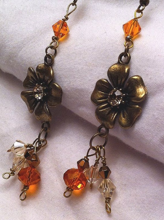 Orange and antiqued gold flower dangle earrings