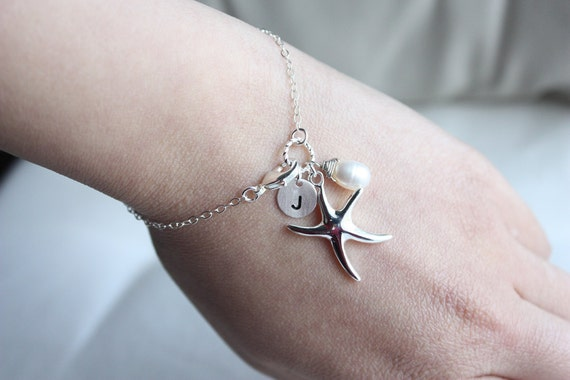 Silver medium starfish charm, hand stamped initial disc charm and pearl bracelet