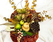Neutral naturals basket centerpiece, dried & faux fruits, pods, leaves; year-round earthy colors, Earth Day, warm brown, green, beige, cream