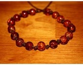 8 Orange Cracked Glass Beads Hand Knotted Bracelet