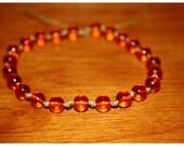 "7 3/4"" Luminescent Orange Beads Hand Knotted Bracelet"