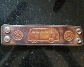 Hand carved leather wrist cuff, VW bus, peace sign