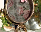vintage gold tone table top angel mirror
