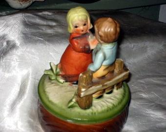 vintage ceramic boy and girl music box