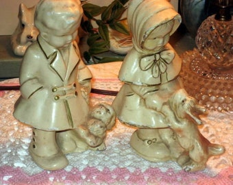 Paris apartment Hollywood regency vintage antique chalkware boy and girl walking thier cutest puppies
