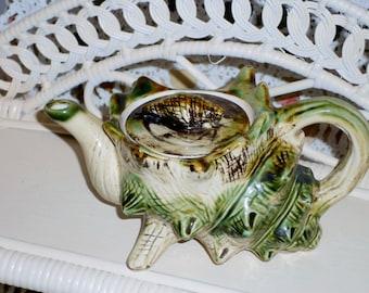 Vintage camouflage tea pot shaped like a sea shell