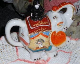 Chinoiserie  vintage Asian satsuma white moriage elephant teapot