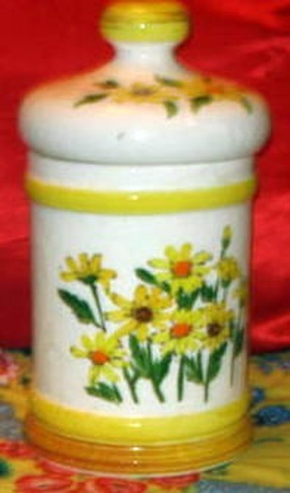 vintage yellow ceramic canister with daisys on it