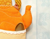 Handmade quilted kettle in tangerine