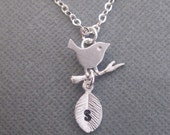 PERSONALIZED Bird on the Branch necklace in STERLING SILVER. Custom Initial on the Leaf.