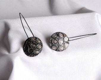 Spots long earrings