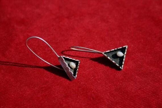 A pearl inside earrings