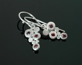 Silver earrings with 6 violet-red sapphires