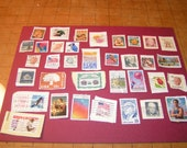 Assprted Stamps.. used.  Jelwery for  altered art items.
