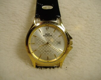 Vintage 1980s Bert Pulizter Quartz Calendar Watch
