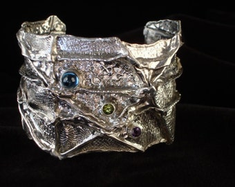 54 OOAK fine silver fold formed SHINY cuff set with blue topaz,amythest and peridot