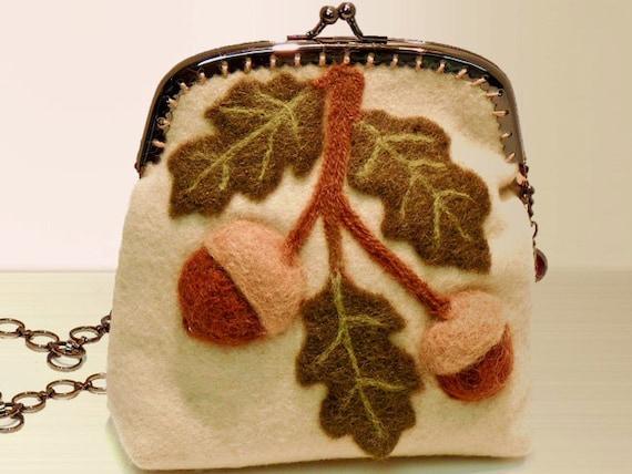 Elegant Acorn Bough wool felt purse with metal frame.