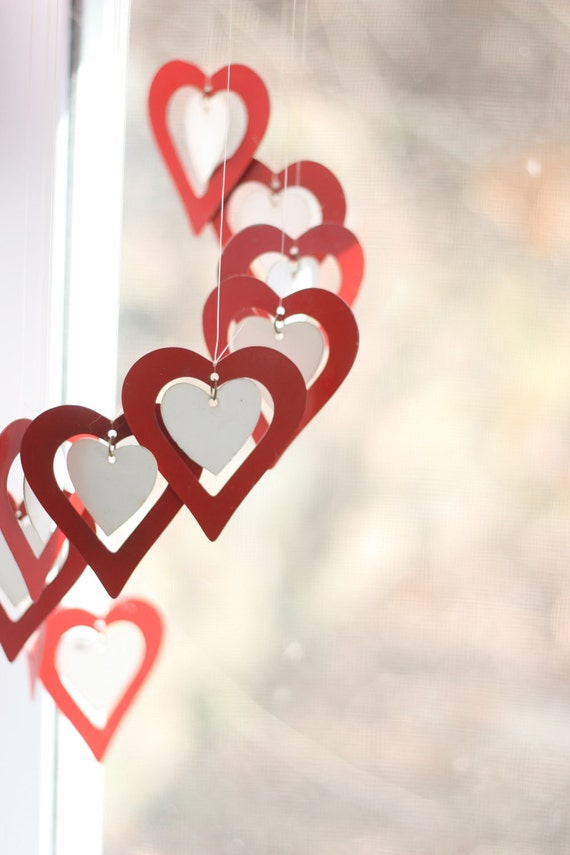 Hearts wind chime, brilliant red with little white centers. Valentine's decoration.
