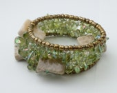 Cuff of Peridot Green Aurora Borealis Nuggets Cream Marble Squares and Gold Glass Beads
