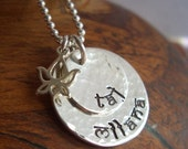 Customized hand stamped sterling silver discs with lotus pendant