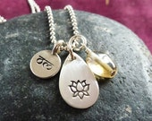 Hand stamped Om, lotus flower teardrop with citrine stone