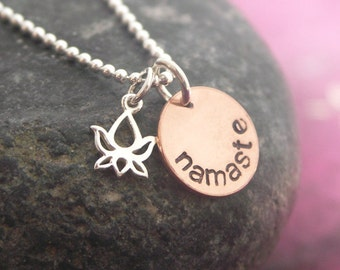 Namaste. Hand stamped copper disc with sterling silver lotus charm