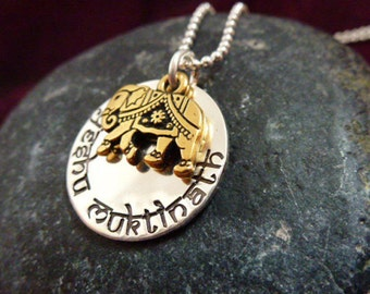Hand stamped customized sterling silver disc with gold plated elephant