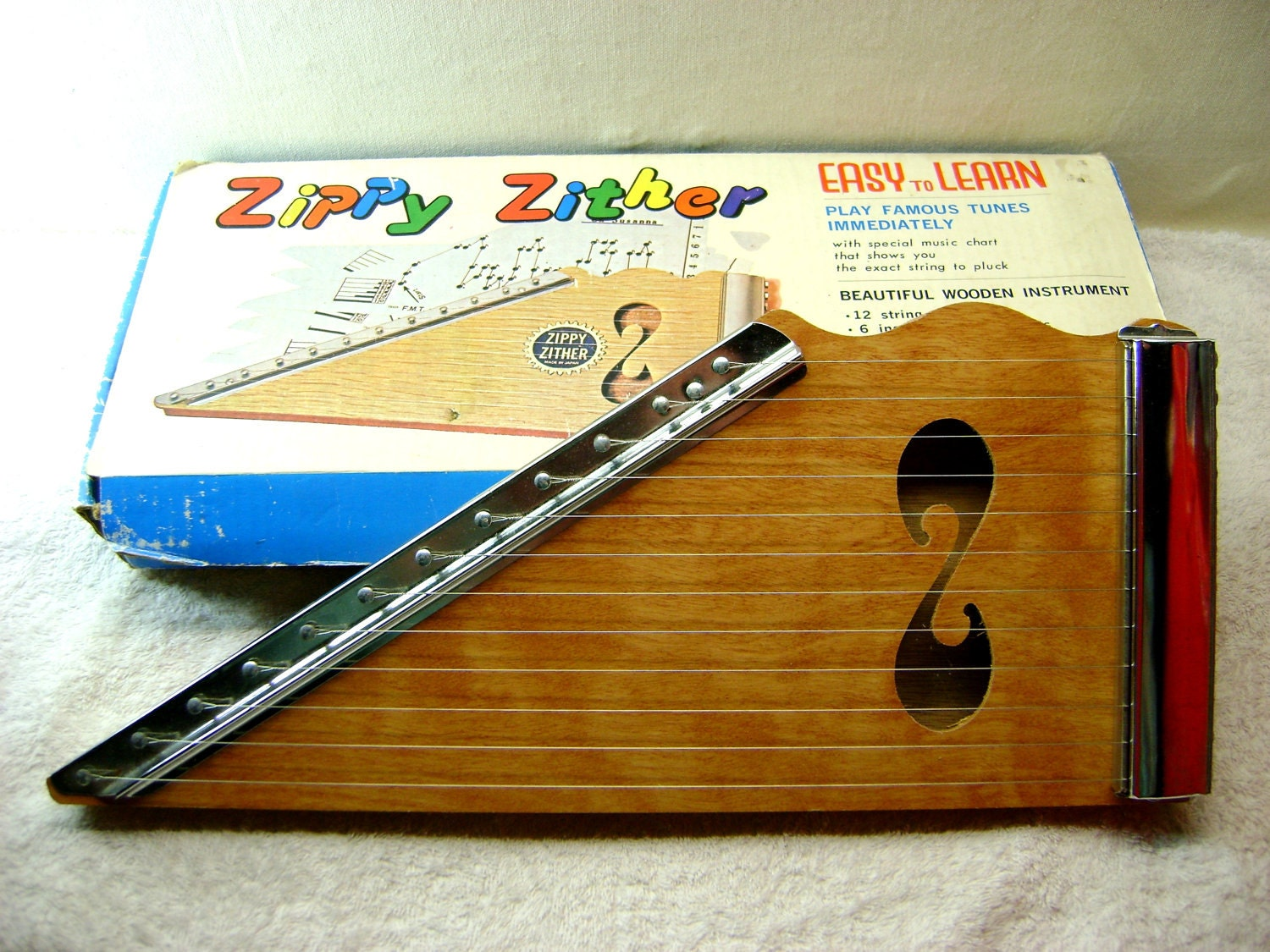 zippy zither in original box with sheet music