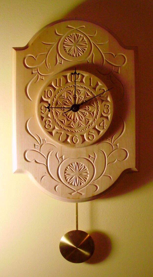 Beautiful chip carved pendulum clock