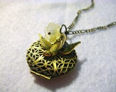 Daffodil Brass Locket Necklace - Antique Brass Filigree Locket with a Yellow Daffodil Flower and Gold Bird Charm