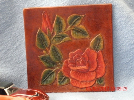Hand tooled red rose drink mat