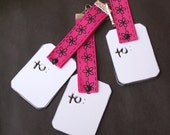Clip-on gift bag tags in hot pink, black, flower and stitch pattern