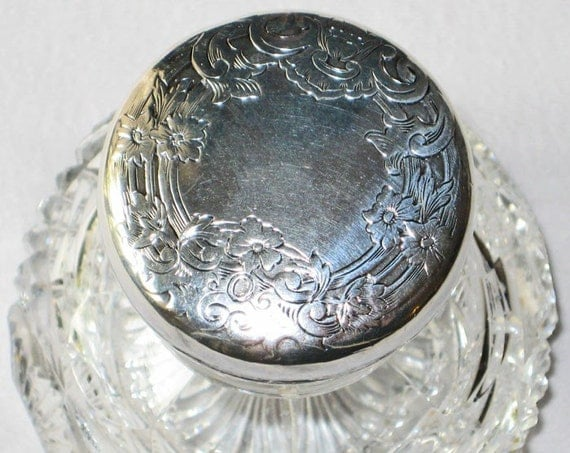 Antique Crystal Perfume Bottle with Engraved Silver Stopper.