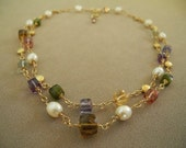 Necklace of faceted gemstone cubes with pearls