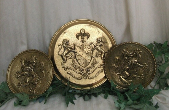Vintage brass wall pockets,wall plaque. Peerage made in England, lion crest.  Free shipping Cont. US