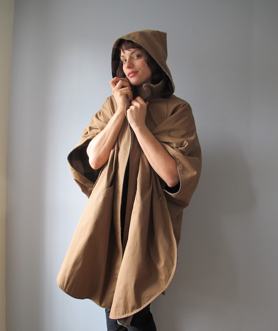 RESERVED for Kara vintage  poncho cloak - Rain Shedder - reversible tan and black  - reversible hood - pockets  - taupe hooded cape