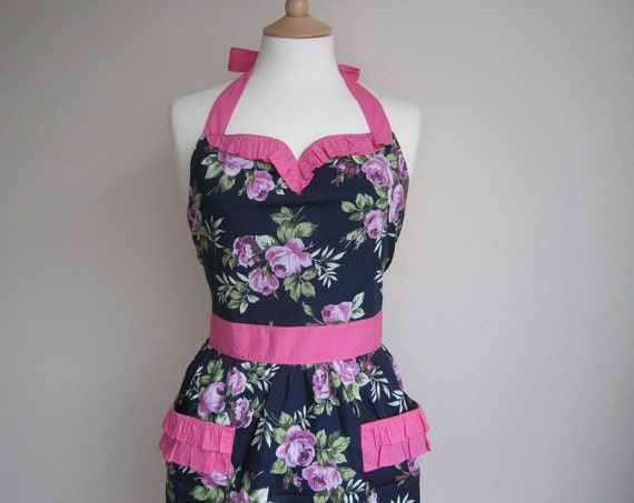 Special offer. Vintage inspired apron with curved ruffle, purple floral pattern on dark blue fabric, fully lined.