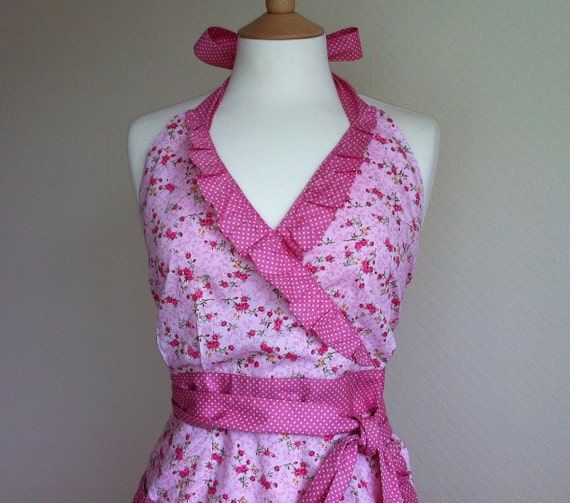 Retro apron sweetie, petite pink flowers on a pink background.1950s inspired, fully lined.