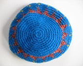 girl's bright blue beret